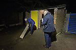 Belper Town v Gresley, 28/01/2014. Christchurch meadow, Northern Premier League. A home club official clearing away building debris outside the turnstile before Belper Town's match against Gresley, in a Northern Premier League, first division south fixture at Christchurch meadow. The home side have played at their current ground since the club was reformed in 1951. Belper won this fixture against their local Derbyshire rivals by 4 goals to 1 watched by a crowd of 165 spectators. Photo by Colin McPherson.