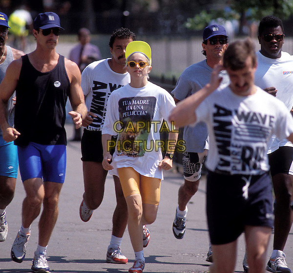 MADONNA..Ref: 026 ..running, training, cap, cycling shorts, bodyguards, paparazzi, full length, full-length..www.capitalpictures.com..sales@capitalpictures.com..©Capital Pictures