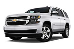 Low aggressive front three quarter view of a 2015 Chevrolet Tahoe 2WD LT 5 Door SUV