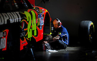 Feb 07, 2009; Daytona Beach, FL, USA; A crew member for NASCAR Sprint Cup Series driver Jeff Gordon (not pictured) works on the car in the garage during practice for the Daytona 500 at Daytona International Speedway. Mandatory Credit: Mark J. Rebilas-