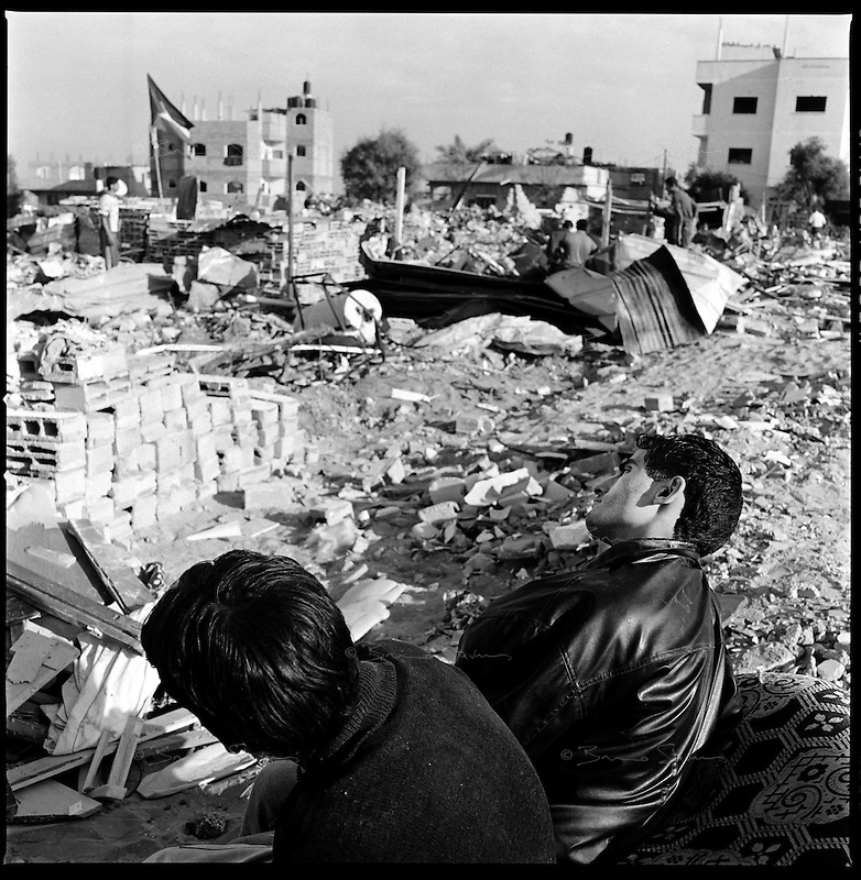 Al Tuam, Gaza Strip, Jan 21 2009.Amadar Garoub, 19, right, is homeless as the family house was destroyed and bulldozed over by the Israeli army..Inhabitants slowly come back to heavily damaged or totally destroyed homes, as fierce fighting between the Israeli army and Hamas took place in this elevated area just north of Gaza city..