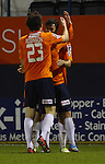 Picture by David Horn/eXtreme Aperture Photography +44 7545 970036<br /> 26/11/2013<br /> Jonathan Smith of Luton Town (rear) celebrates scoring with Luke Guttridge of Luton Town (centre) and Matt Robinson of Luton Town (front) during the Skrill Premier match at Kenilworth Road, Luton.