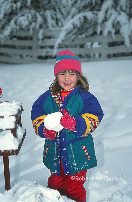 Girl with snow ball