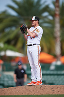 Baltimore Orioles relief pitcher Josh Rogers (65) looks in for the sign during a Grapefruit League Spring Training game against the Tampa Bay Rays on March 1, 2019 at Ed Smith Stadium in Sarasota, Florida.  Rays defeated the Orioles 10-5.  (Mike Janes/Four Seam Images)