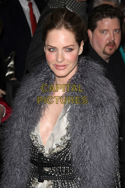 TRINNY WOODALL.The world premiere of 'Love Never Dies', Adelphi Theatre, London, England..March 9th, 2010.half length grey gray fur wrap shawl plunging neckline hair up black belt beads beaded white .CAP/AH.©Adam Houghton/Capital Pictures.