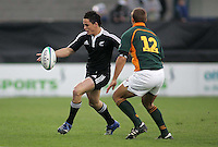 New Zealand winger Zach Gildford chips South African centre Stefan Watermeyer during the U19 Championship final against South Africa at Ravenhill, Belfast.