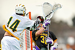 10 April 2011: University of Vermont Catamount midfielder Thomas Galvin, a Sophomore from Cockeysville, MD, takes a shot on goalkeeper John Carroll, a Junior from Nesconset, NY, during game action against the University at Albany Great Danes on Moulton Winder Field in Burlington, Vermont. The Catamounts defeated the visiting Danes 11-6 in America East play. Mandatory Credit: Ed Wolfstein Photo