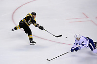April 25, 2018: Boston Bruins left wing Brad Marchand (63) shoots during game seven of the first round of the National Hockey League's Eastern Conference Stanley Cup playoffs between the Toronto Maple Leafs and the Boston Bruins held at TD Garden, in Boston, Mass. Boston defeats Toronto 7-4 and wins the best of seven series 4 games to 3 to advance to round two.