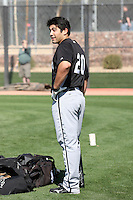 Carlos Quentin #20 of the Chicago White Sox participates in spring training workouts at the White Sox training facility on February 24, 2011  in Glendale, Arizona. .Photo by:  Bill Mitchell/Four Seam Images.