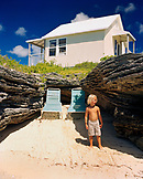 BERMUDA, 9 Beaches Resort, boy standing in beach with a cabana in the background