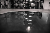 USA, Oregon, Willamette Valley, a pool of water reflects barrels of wine in the wine cellar at Domaine Drouhin, Dundee