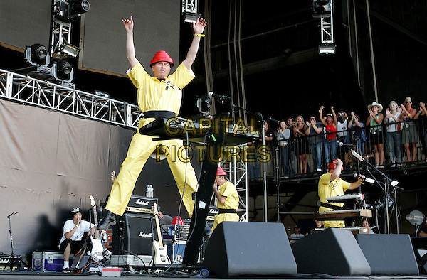 DEVO.The KROQ Miller Lite Inland Invasion 4 held at The Hyundai Pavilion at Glen Helen Devore, California .September 18, 2004.stage, concert, music, live, gig, full length, costumes, yellow.www.capitalpictures.com.sales@capitalpictures.com.Copyright by Debbie VanStory