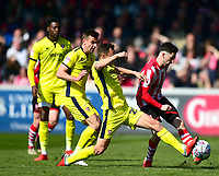 Lincoln City's Tom Pett battles with Cheltenham Town's Billy Waters<br /> <br /> Photographer Andrew Vaughan/CameraSport<br /> <br /> The EFL Sky Bet League Two - Lincoln City v Cheltenham Town - Saturday 13th April 2019 - Sincil Bank - Lincoln<br /> <br /> World Copyright © 2019 CameraSport. All rights reserved. 43 Linden Ave. Countesthorpe. Leicester. England. LE8 5PG - Tel: +44 (0) 116 277 4147 - admin@camerasport.com - www.camerasport.com