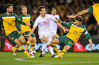 MELBOURNE, AUSTRALIA - JUNE 7: Jonathan McKain of the Socceroos tackles Radosav Petrovic of Serbia during an international friendly match between the Qantas Australian Socceroos and Serbia at Etihad Stadium on June 7, 2011 in Melbourne, Australia. Photo by Sydney Low / AsteriskImages.com