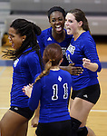 From left, Marymount's Cailyn Thomas, Bri Fitzpatrick, Morgan McAlpin and Erin Allison celebrate a point during a college volleyball match at Washington & Lee University Lexington, Vir., on Saturday, Oct. 5, 2013.<br /> Photo by Cathleen Allison
