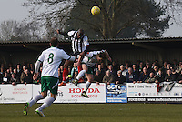 Anthony Straker of Grimsby Town wins the header during the FA Trophy Semi Final first leg match between Bognor Regis and Grimsby Town at Nyewood Lane, Bognor Regis, England on 12 March 2016. Photo by Paul Paxford/PRiME Media Images.