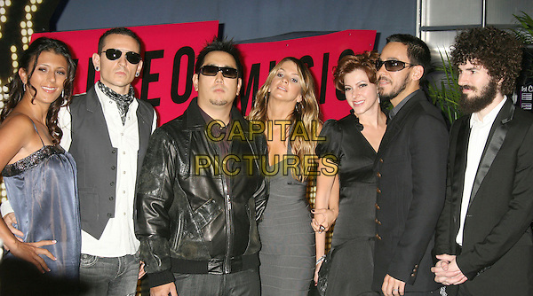 LINKIN PARK (WITH GIRLFRIENDS & WIVES).2007 MTV Video Music Awards held at the Palms Resort & Casino, Las Vegas, Nevada, USA..September 9th, 2007.half length black shirt beard facial hair sunglasses shades dress couples .CAP/ADM/RE.©Russ Elliot/AdMedia/Capital Pictures.
