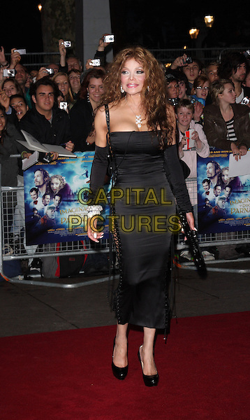 "LA TOYA JACKSON .Attending the UK film premiere of ""The Imaginarium Of Doctor Parnassus"" at the Empire Leicester Square cinema, London, England, UK, October 6th 2009..Latoya full length black lace-up sides corset dress platform patent christian louboutin shoes clutch bag silver diamond bracelets sleeves arm warmers cleavage .CAP/ROS.©Steve Ross/Capital Pictures"
