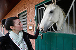 Allison pets a horse in a stable at Ardenode Stud, County Kildare, Ireland on Sunday, June 23rd 2013. (Photo by Brian Garfinkel)