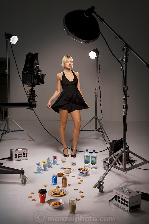 Mariel Booth, a professional model and New York University student, at the Ten Ton Studio in Brooklyn with her typical day's worth of food. (From the book What I Eat: Around the World in 80 Diets.) The caloric value of her day's worth of food on a day in the month of October was 2400 kcals. She is 23 years of age; 5 feet, 9.5 inches tall; and 135 pounds. At a healthier weight than when modeling full-time, she feels good but laments that she's making much less money. MODEL RELEASED.