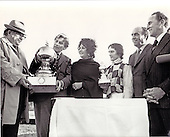 """Actress Elizabeth Taylor, future wife of former United States Navy Secretary John Warner, is shown in the winner's circle following the running of the D.C. International Horse Race in Laurel, Maryland on November 6, 1976.  From left to right:  Nelson Bunker Hunt, owner of the winning horse """"Youth""""; former U.S. Navy Secretary Warner; Elizabeth Taylor; winning jockey Maurice Zilber; and Laurel Race Track president Joseph Shapiro.  The winner of the race won $150,000.00..Credit:  Benjamin E. """"Gene"""" Forte / CNP"""
