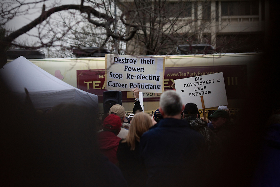 Topeka, Kansas, April 2, 2010 - Tea Party supporters braved heavy rain to attend a Tea Party Express rally on the Capitol steps. The tour which began in Searchlight, NV, hometown of Senate Majority Leader Harry Reid, will wind through the 43 cities across the United States ending up in Washington, D.C. on April 15 for a tax day rally..