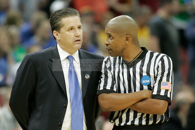 A referee speaks with John Calipari during the second half of the UK vs. Iowa State NCAA third round game at the KFC Yum! Center March 17, 2012. Photo by Brandon Goodwin | Staff
