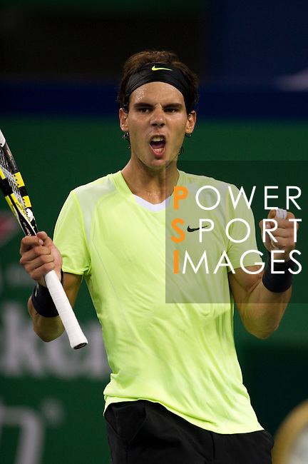 SHANGHAI, CHINA - OCTOBER 13:  Rafael Nadal of Spain celebrates match point to Stanislas Wawrinka of Switzerland during day three of the 2010 Shanghai Rolex Masters at the Shanghai Qi Zhong Tennis Center on October 13, 2010 in Shanghai, China.  (Photo by Victor Fraile/The Power of Sport Images) *** Local Caption *** Rafael Nadal