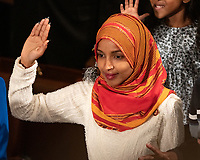 United States Representative Ilhan Omar (Democrat of Minnesota) is sworn-in as the 116th Congress convenes for its opening session in the US House Chamber of the US Capitol in Washington, DC on Thursday, January 3, 2019. Photo Credit: Ron Sachs/CNP/AdMedia