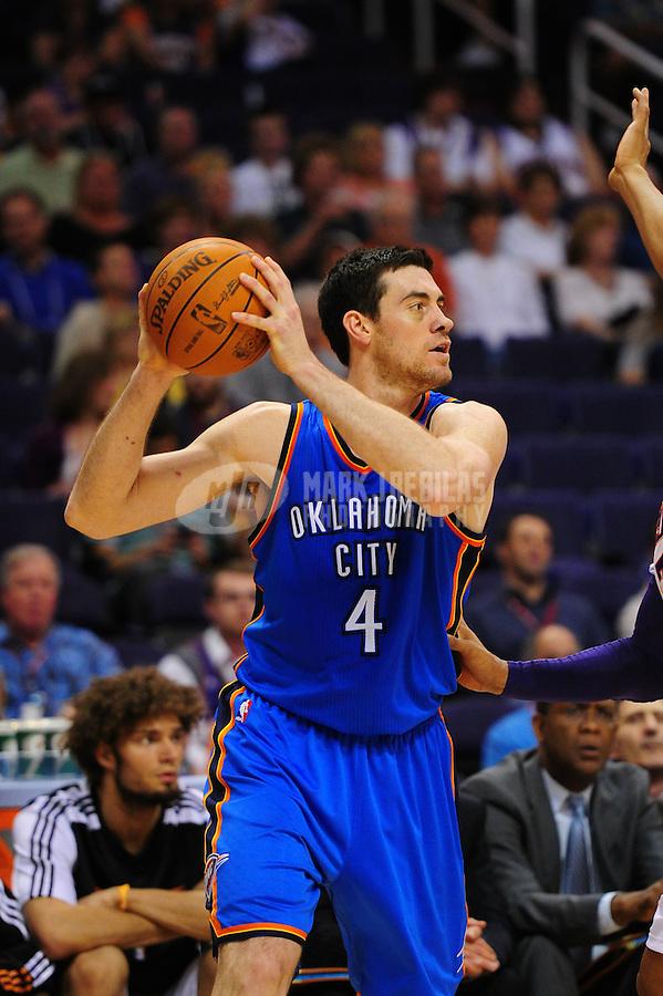 Mar. 30, 2011; Phoenix, AZ, USA; Oklahoma City Thunder forward (4) Nick Collison against the Phoenix Suns at the US Airways Center. Mandatory Credit: Mark J. Rebilas-