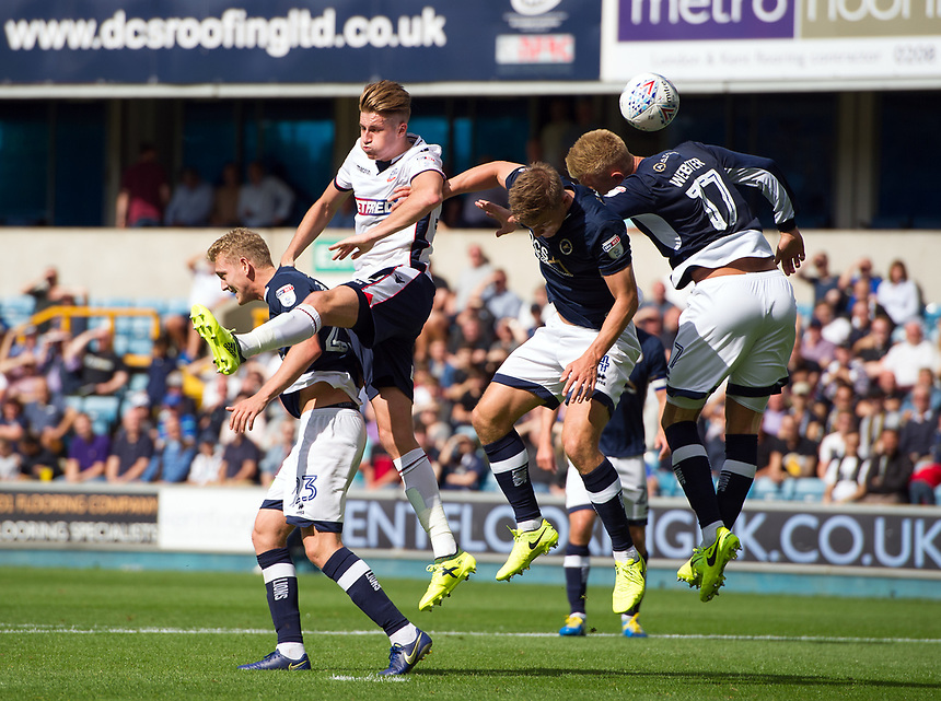 Bolton Wanderers' Reece Burke battles for possession with Millwall's George Saville<br /> <br /> Photographer Ashley Western/CameraSport<br /> <br /> The EFL Sky Bet Championship - Millwall v Bolton Wanderers - Saturday August 12th 2017 - The Den - London<br /> <br /> World Copyright &not;&copy; 2017 CameraSport. All rights reserved. 43 Linden Ave. Countesthorpe. Leicester. England. LE8 5PG - Tel: +44 (0) 116 277 4147 - admin@camerasport.com - www.camerasport.com