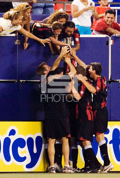 The MetroStars' Amado Guevara celebrates scoring a hat trick with fans and teammates after his stoppage time goal. The MetroStars tied CD Chivas USA  3 - 3 at Giant's Stadium, East Rutherford, NJ, on August 21, 2005.