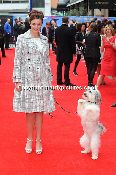 NON EXCLUSIVE PICTURE: PAUL TREADWAY / MATRIXPICTURES.CO.UK<br /> PLEASE CREDIT ALL USES<br /> <br /> WORLD RIGHTS<br /> <br /> Britain's Got Talent 2012 winners Ashleigh Butler and Pudsey attend the World Premiere of Postman Pat: The Movie, Odeon West End, London.<br /> <br /> MAY 11th 2014<br /> <br /> REF: PTY 142244