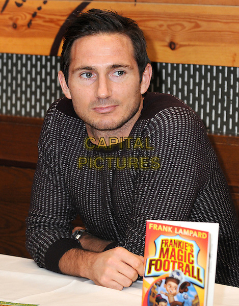 LONDON, ENGLAND - OCTOBER 31:  Frank Lampard signs copies of his new children's book 'Frankie versus The Cowboy Crew' at Giraffe bookshop, Marylebone, October 31st, 2013 in London, England, UK.<br /> CAP/PP/BK<br /> &copy;Bob Kent/PP/Capital Pictures