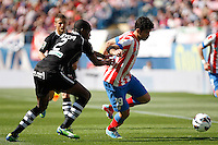 Atletico's Diego Costa and Granada's Nyom during La Liga BBVA match. April 14, 2013.(ALTERPHOTOS/Alconada)