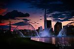 Night or dusk skyline of Dayton Ohio with fountains.