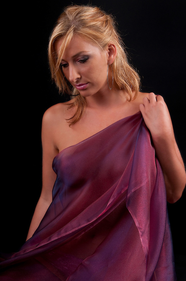 Young woman pensive covered with fabric