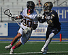 Ethan Insinga #30 of Wantagh, left, gets pressured by Matthew Schneider #26 of Bethpage during the Nassau County varsity boys lacrosse Class C semifinals at Shuart Stadium, located on the campus Hofstra University in Hempstead, on Friday, May 25, 2018. Wantagh won by a score of 12-8.