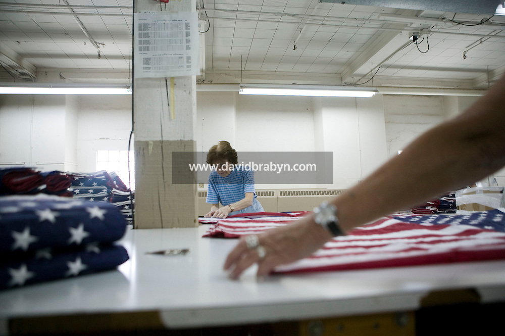 1 June 2005 - Oaks, PA - Workers fold American flags at the Annin & Co. flag manufacturing plant in Oaks, PA. Photo Credit: David Brabyn.