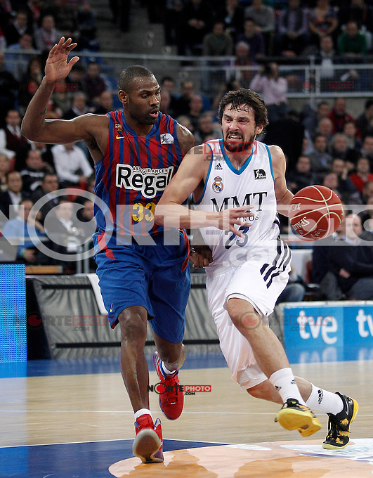 Real Madrid's Sergio Llull (r) and FC Barcelona Regal's Pete Mickeal during Spanish Basketball King's Cup match.February 07,2013. (ALTERPHOTOS/Acero) /Nortephoto