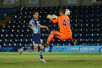 Sam Howes of West Ham United U21s (right) saves a shot from Scott Kashket of Wycombe Wanderers during the The Checkatrade Trophy match between Wycombe Wanderers and West Ham United U21 at Adams Park, High Wycombe, England on 4 October 2016. Photo by David Horn.