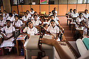 Young Sri Lankan students attend a class on vaccination in the Nursing School in Vavuniya, Sri Lanka.  Photo: Sanjit Das/Panos