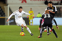 (L-R) Gylfi Sigurdsson of Swansea against Ben Watson of Watford during the Barclays Premier League match between Swansea City and Watford at the Liberty Stadium, Swansea on January 18 2016