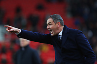 Swansea City manager Paul Clement shouts instructions during the Premier League match between Stoke City and Swansea City at the bet365 Stadium, Stoke on Trent, England, UK. Saturday 02 December 2017