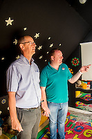Friday  12 August 2016<br /> Pictured: Admin staff and funding manager Emyr Beynon (R)shows Amazon manager Pat Faulkner (L) the sensory room<br /> Re: The Amazon team in Swansea has made a recent donation of £1,000 to Carmarthen Breakthro charity. The Amazon team are visited the charity to learn more about what they do and how they plan to use the money.