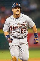 Detroit Tigers third baseman Miguel Cabrera (24) sprints to third base after tagging up on a fly ball in the fourth inning of the MLB baseball game against the Houston Astros on May 3, 2013 at Minute Maid Park in Houston, Texas. Detroit defeated Houston 4-3. (Andrew Woolley/Four Seam Images).