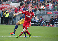 Toronto, Ontario - May 17, 2014: Toronto FC defender Steven Caldwell #13 and New York Red Bulls forward Thierry Henry #14 in action during a game between the New York Red Bulls and Toronto FC at BMO Field. Toronto FC won 2-0.