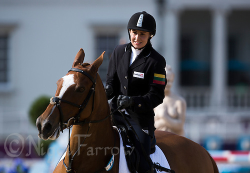 12 AUG 2012 - LONDON, GBR - Laura Asadauskaite (LTU) of Lithuania walks her horse All Rise after completing her round during the women's London 2012 Olympic Games Modern Pentathlon riding in Greenwich Park, Greenwich, London, Great Britain .(PHOTO (C) 2012 NIGEL FARROW)