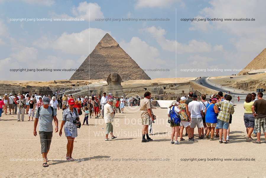 "Afrika Nordafrika Ägypten Kairo Cairo .Touristen an den Pyramiden und Sphinx von Giza Gizeh  - Megacity Metropole Orient Sand Wüste xagndaz | .Africa north africa arabia Egypt Cairo  .tourist at pyramid of Giza Gizeh -  tourism travel tour desert city sand .| [ copyright (c) Joerg Boethling / agenda , Veroeffentlichung nur gegen Honorar und Belegexemplar an / publication only with royalties and copy to:  agenda PG   Rothestr. 66   Germany D-22765 Hamburg   ph. ++49 40 391 907 14   e-mail: boethling@agenda-fototext.de   www.agenda-fototext.de   Bank: Hamburger Sparkasse  BLZ 200 505 50  Kto. 1281 120 178   IBAN: DE96 2005 0550 1281 1201 78   BIC: ""HASPDEHH"" ] [#0,26,121#]"