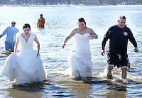 From left, Amber Kenney, Karli Krug and Adam Bockius exit the 32 degree Delaware River during the eighth annual Eastern Polar Bear Plunge to benefit Special Olympics Pennsylvania (SOPA) Saturday January 30, 2016 at Neshaminy State Park in Bensalem, Pennsylvania. (Photo by William Thomas Cain)